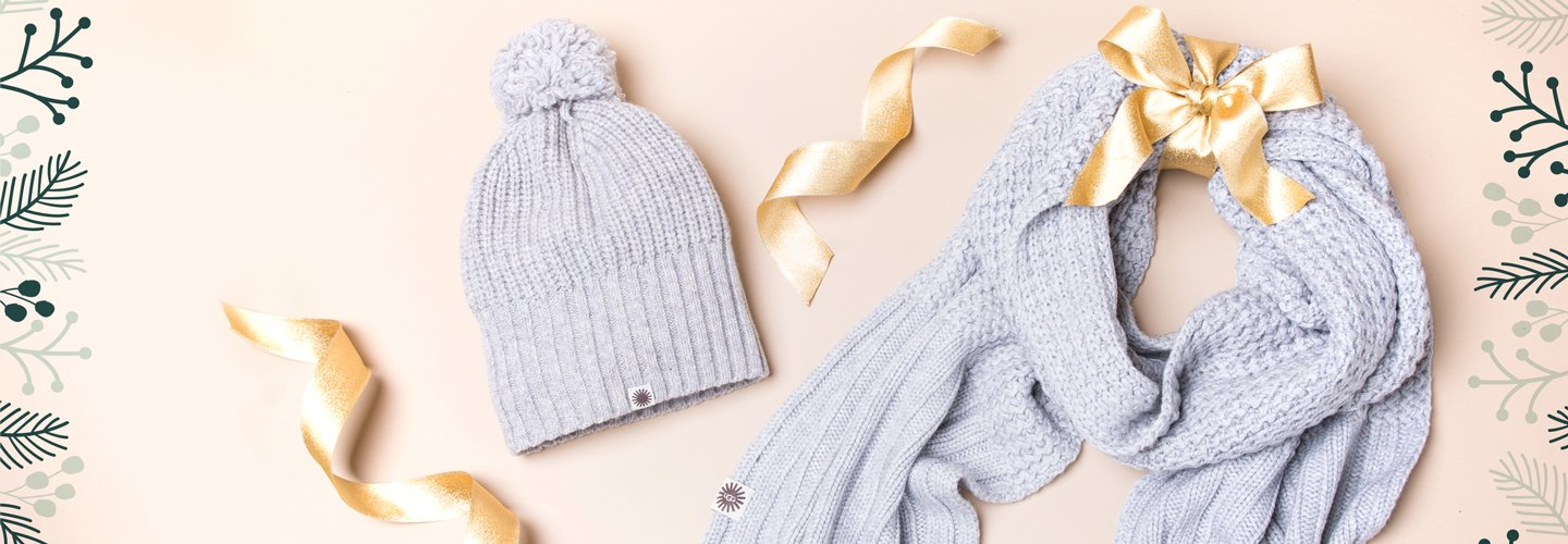 Image of a grey UGG scarf and beanie.