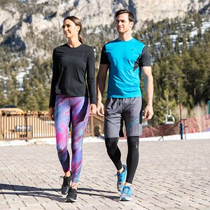 Man and Woman wearing Spyder apparel.