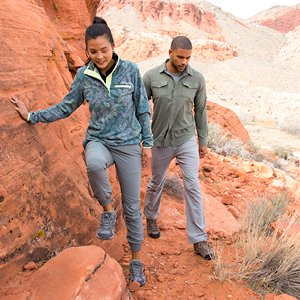 Man and woman hiking wearing Columbia apparel and footwear.