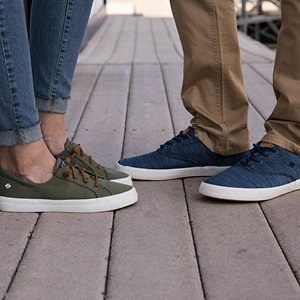 Image of woman and man wearing Sperry footwear.