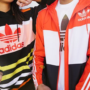Image of man and woman wearing Adidas apparel.