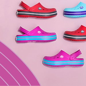Image of pink, red and blue crocs clogs.