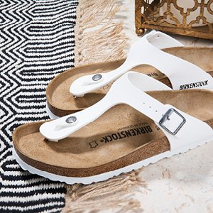Image of white Birkenstock sandals.