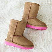 image of UGG Boots and a furry white background.