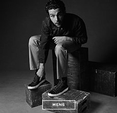 cp-2-mens-2017-08-15 Shop Mens. Black and white image of a man sitting on boxes.