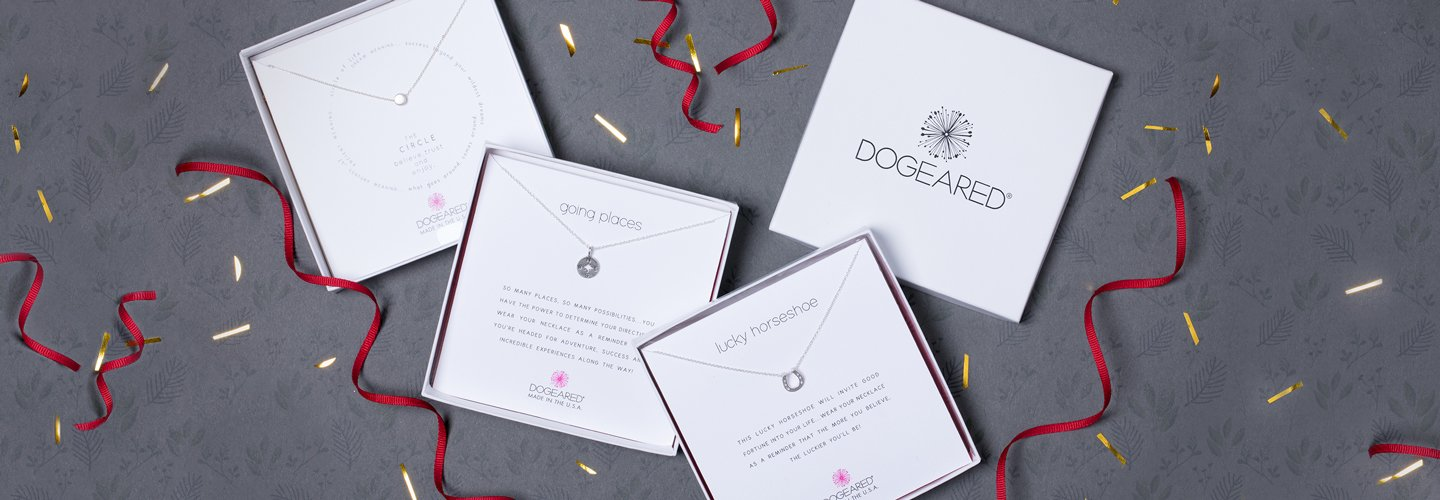 Image of 3 necklaces in gift boxes with ribbon and confetti.