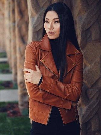 Woman wearing brown leather jacket