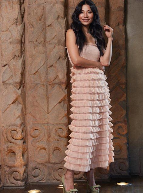 Woman wearing ruffled peach dress