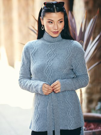 Woman wearing grey cashmere sweater