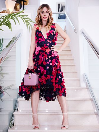 Woman wearing black and pink floral dress.