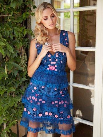 Image of woman wearing blue dress.
