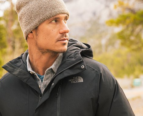 Image of man  outside and styled in The North Face outerwear. Image links to North Face December lookbook.
