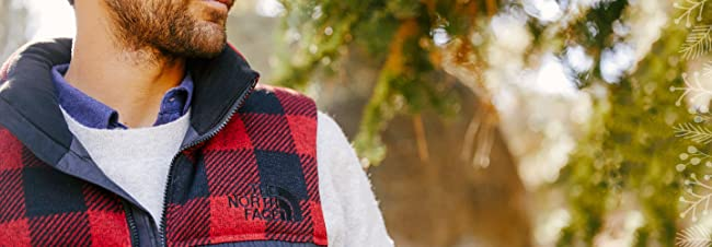 image of a man wearing The North Face vest. image links to a collection of The North Face clothing, shoes and accessories for men, women and children.