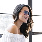 Woman wearing sunglasses and white off-the-shoulder-top
