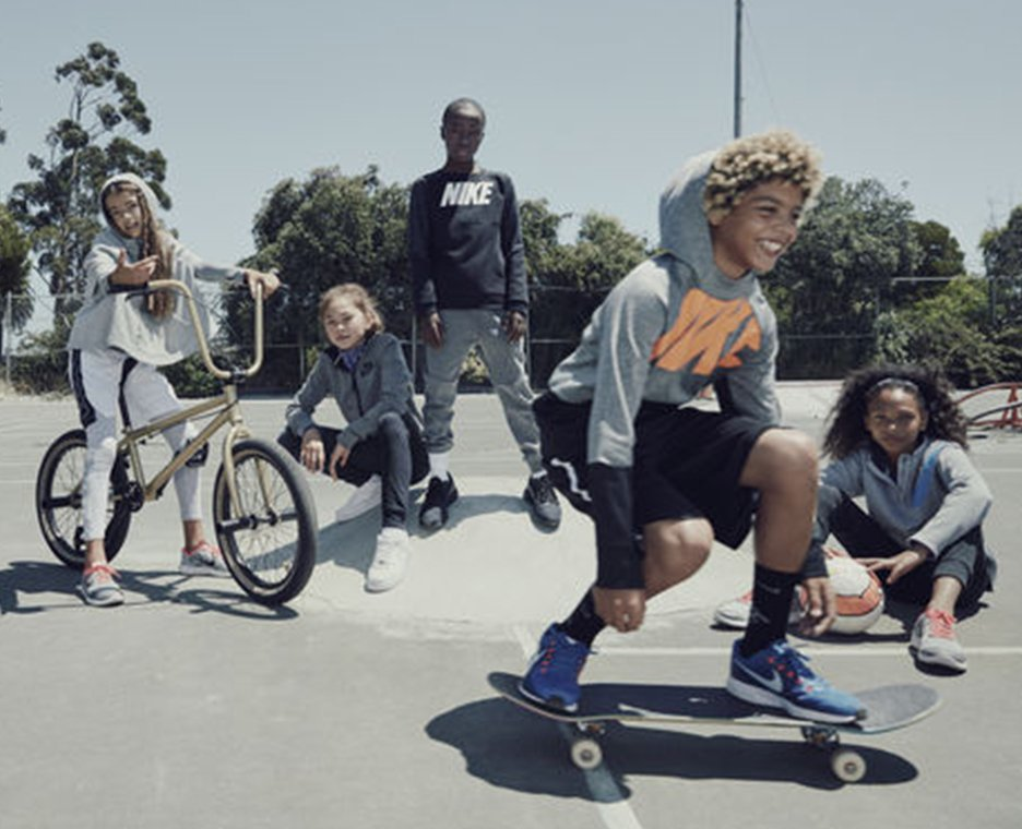 Image of boys and girls dressed in Nike apparel