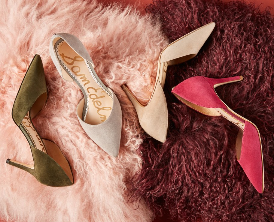 product shot of 4 heels on fuzzy blanket