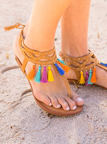 Tassels. Sandals with tassel embellishments.