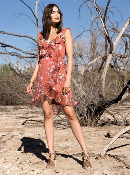 Floral Fantasy. Woman wearing pink floral dress with ruffles.