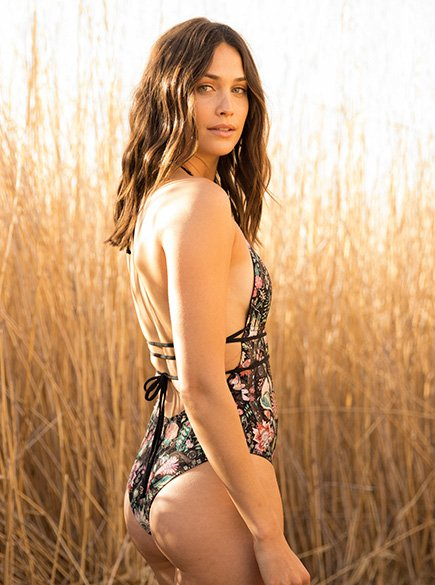 Sexy Swim. Woman wearing floral one-piece swimsuit.