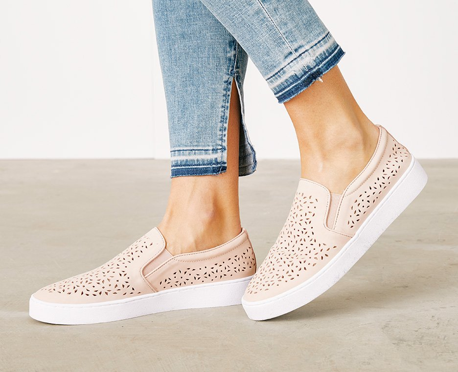 Image of Women in pink perforated sneakers