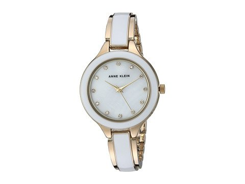 cp-2-06-13-2017 Shop Metal Watches. Image of white and gold watch.