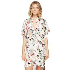 Image of woman wearing a floral dress