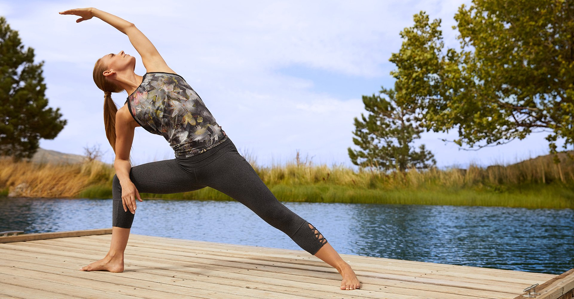 Image of Woman in Yoga Extended Side Angle Pose. Image links to Leggings new arrivals.