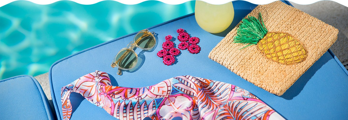 Clickable image of spring accessories next to a pool.