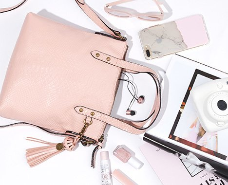 Image of pink The Sak tote spilling out contents.