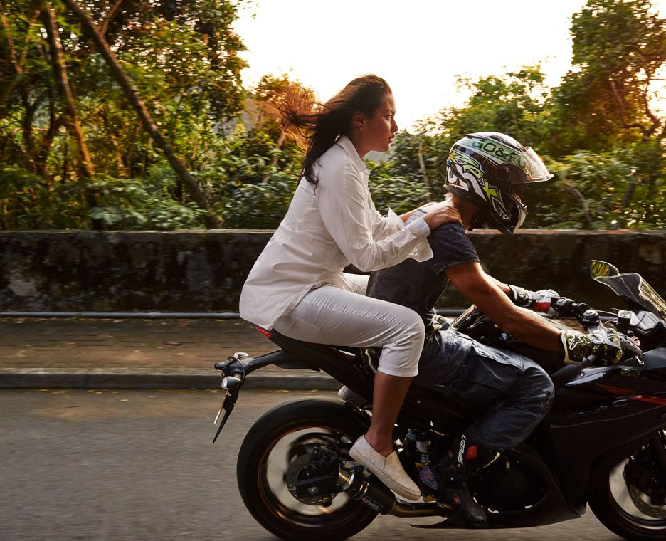 Image of woman riding motorcycle wearing Clarks