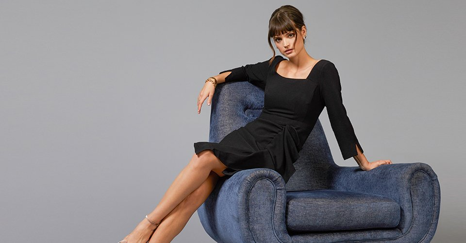 Clickable image of a woman wearing a black dress.