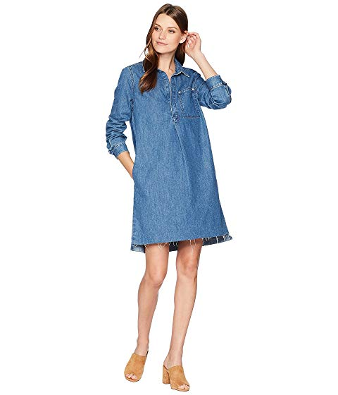 Image of woman in denim fabric dress.