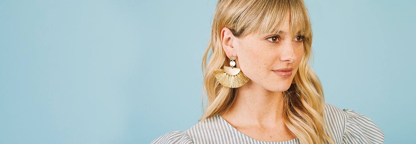 image of woman wearing statement earrings