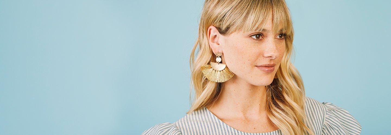 image of woman wearing statement earrings