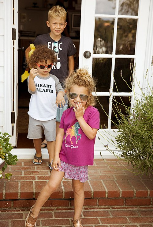 Image links to all  kids' graphic tees.