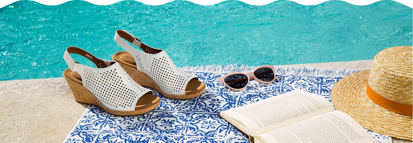 Image of comfort wedge shoes by the pool.