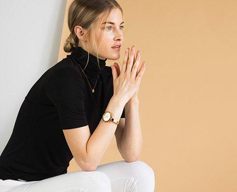 Image of woman wearing a Michael Michael Kors watch,
