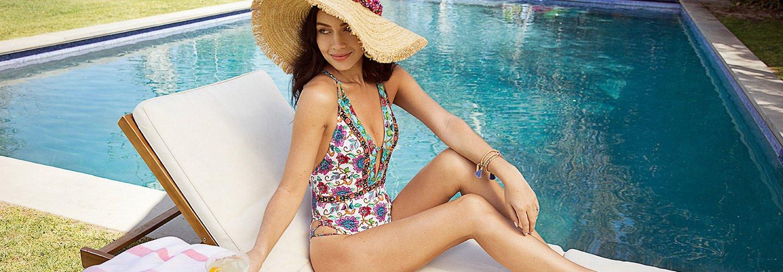 A woman wearing a Nanette Lepore bathing suit.