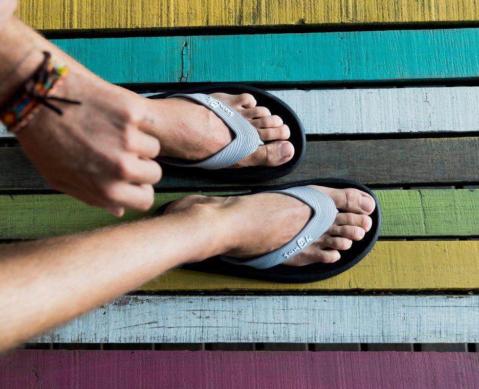 Image of model wearing sanuk sandals