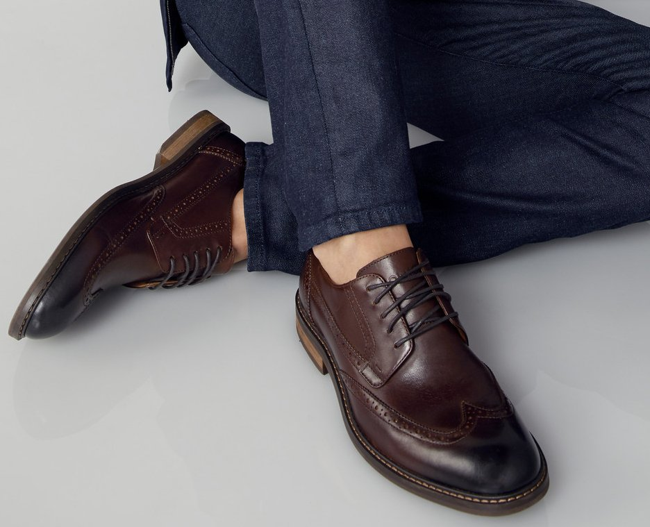 Clickable image of a man wearing leather oxfords.