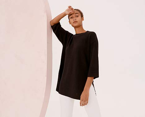 Clickable Image of a woman wearing a white Eileen Fisher outfit