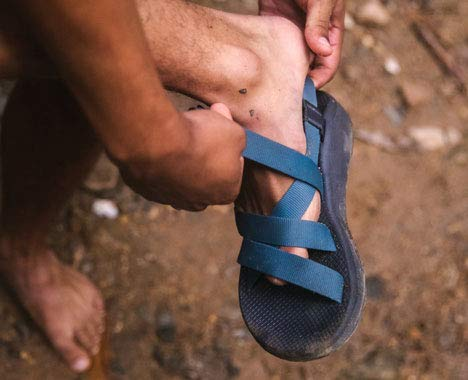 Image of a person putting on a sandal