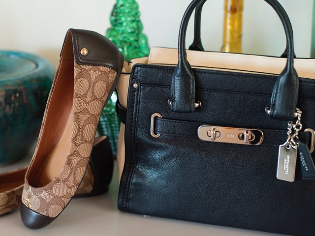 A 3/27 - Chestnut COACH Flats And Black And White Handbag