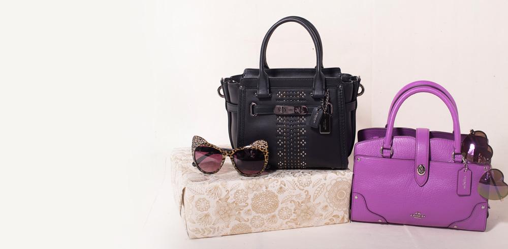 A 5/22 - COACH Black Handbag And Purple Handbag