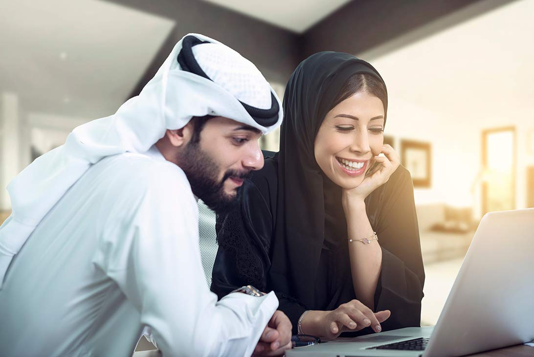 Young couple looking at a laptop
