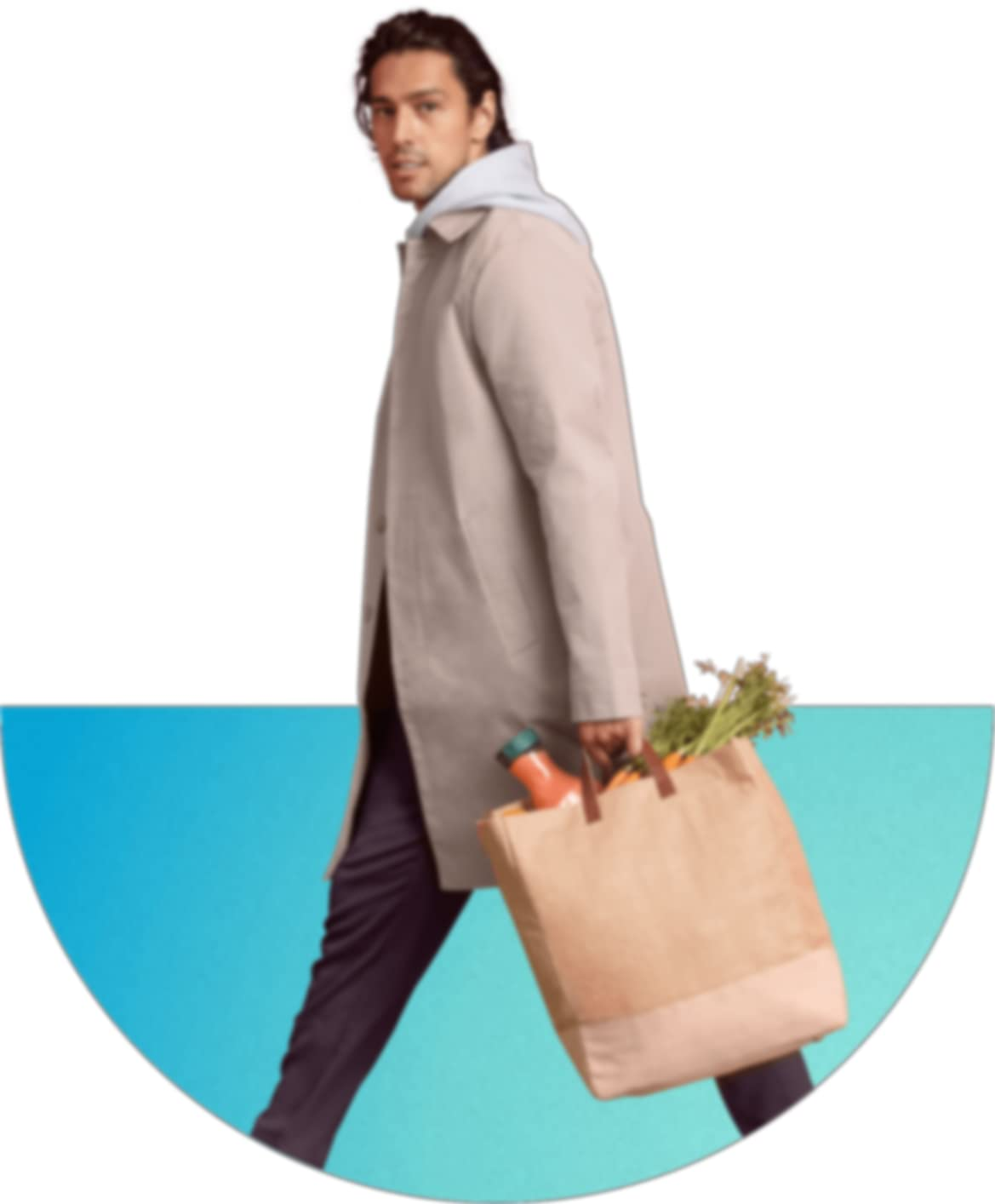 A man in a coat holding bag of groceries