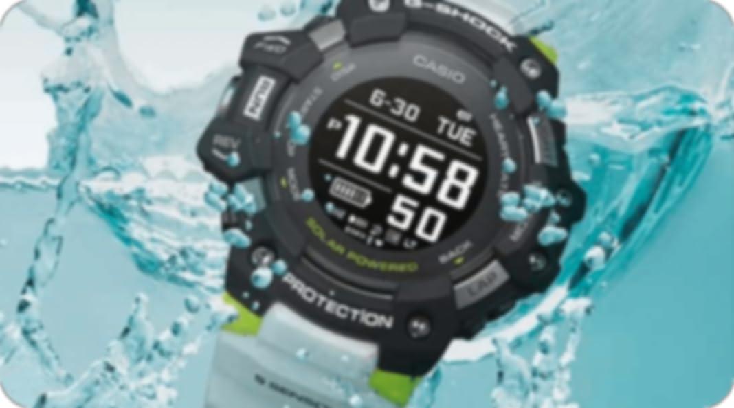 a black casio g-shock watch  with water around it