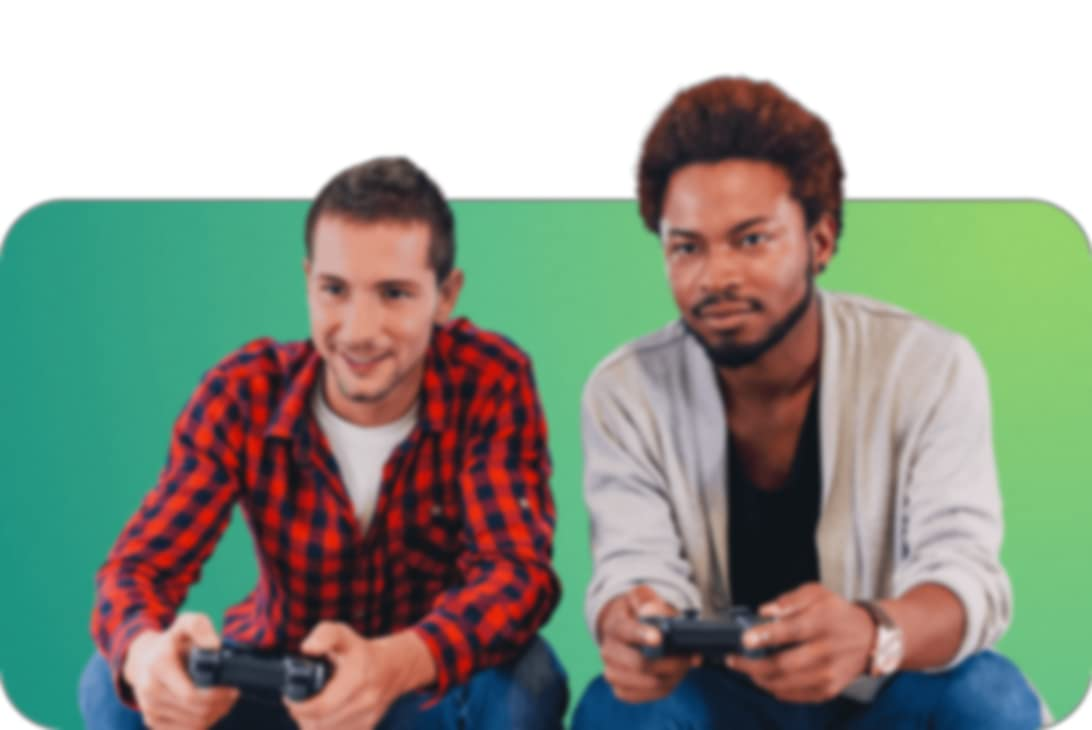 two people sitting down playing video games with controllers in their hands