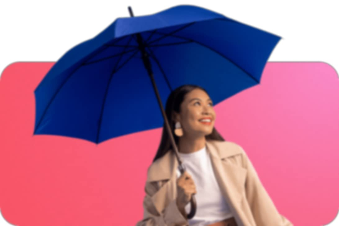 person with a blue umbrella over their head looking away while wearing a beige jacket over a white top