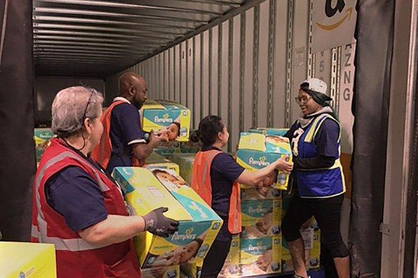 Amazon Associates prepare diaper donation.